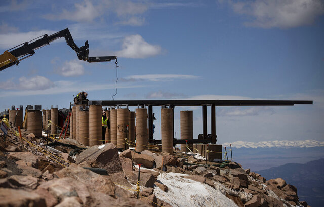 Construction continues on the 38,000-square foot Pikes Peak summit house complex on the summit of 14,115-foot Pikes Peak above Manitou Springs, Colo., on Wednesday, May 13, 2020. Crews broke ground last June on the $60 million project to replace the original Summit House, built in 1963. (Chancey Bush/The Gazette via AP)
