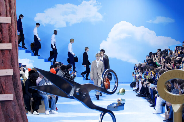CAPTION CORRECTS THE SEASON - Models wear creations for the Vuitton Mens Fall/Winter 2020-2021 fashion collection presented in Paris, Thursday Jan. 16, 2020. (AP Photo/Francois Mori)