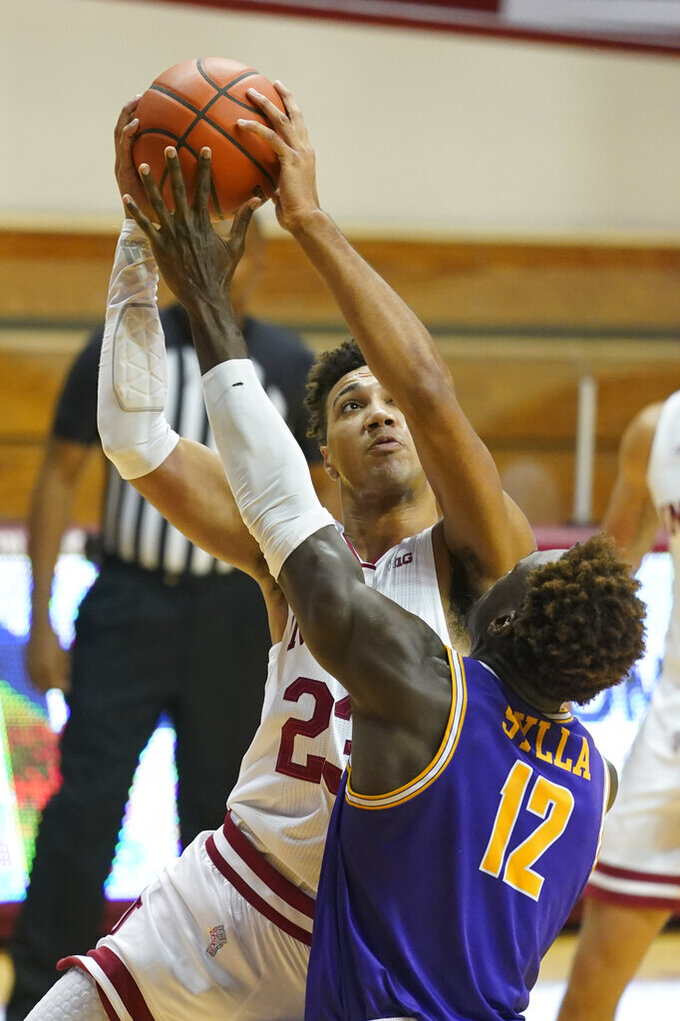 Indiana's Trayce Jackson-Davis (23) shoots over Tennessee Tech's Amadou Sylla (12) during the first half of an NCAA college basketball game, Wednesday, Nov. 25, 2020, in Bloomington, Ind. (AP Photo/Darron Cummings)