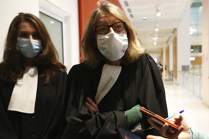 Luigi Ventura 's lawyer Solange Doumic, right, answers journalists after the verdict, Wednesday, Dec. 16, 2020 in Paris. A Paris court on Wednesday convicted former Vatican ambassador to France 76-year-old Luigi Ventura of sexually assaulting five men in 2018 and 2019, and handed him a suspended 8-month prison sentence. (AP Photo/Michel Euler)