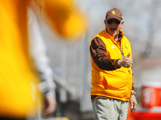 FILE - In this April 13, 2019, file photo, Wyoming coach Craig Bohl calls out to a referee during the NCAA college football team's spring scrimmage in Casper, Wyo. When Wyoming coach Bohl looks at the Missouri offense this year, he doesn't see signs of any drop off from an offense that averaged 36.6 point a game last year behind quarterback Drew Lock, who has since moved on to the NFL. (Josh Galemore//The Casper Star-Tribune via AP, File)