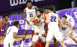 Northwestern guard Boo Buie (0) grabs a rebound as Ohio State forward E.J. Liddell (32) fouls him during the second half of an NCAA college basketball game, Saturday, Dec. 26, 2020, in Evanston, Ill. (AP Photo/David Banks)
