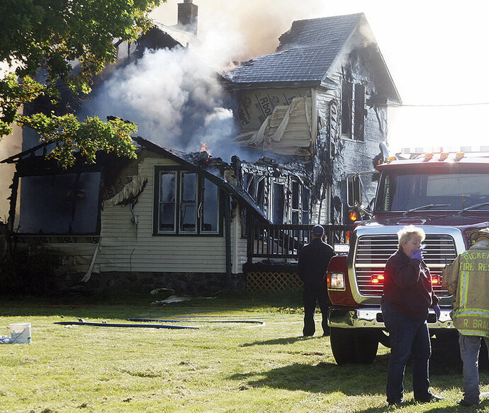 Responders work the scene of a deadly house fire in Pickerel, Wis., Tuesday, June 25, 2019. Authorities say several people, including four children, have died in the house fire in the small Wisconsin town. (Antigo Daily Journal via AP)