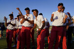 The USA team celebrates their win against the Great Britain and Ireland team in the Walker Cup golf tournament at the Seminole Golf Club on Sunday, May 9, 2021, in Juno Beach, Fla. (AP Photo/Brynn Anderson)