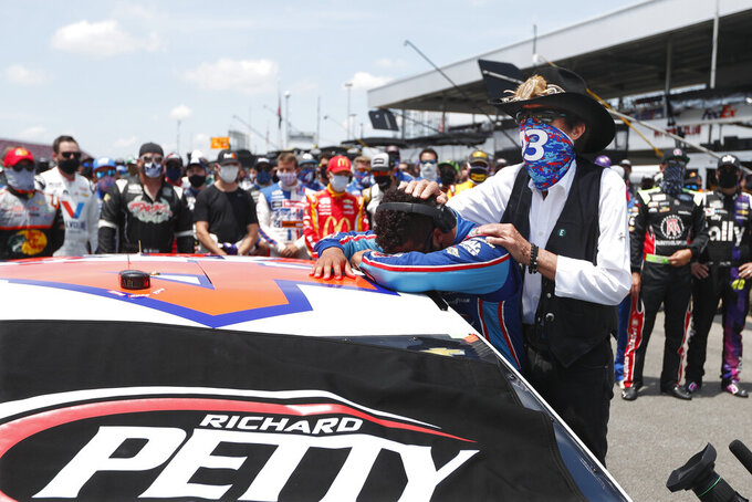 FILE - In this June 22, 2020, file photo, Driver Bubba Wallace is consoled by team owner Richard Petty prior to the start of the NASCAR Cup Series at the Talladega Superspeedway in Talladega, Ala. The Cup Series returns to Talladega on Sunday. (AP Photo/John Bazemore, File)