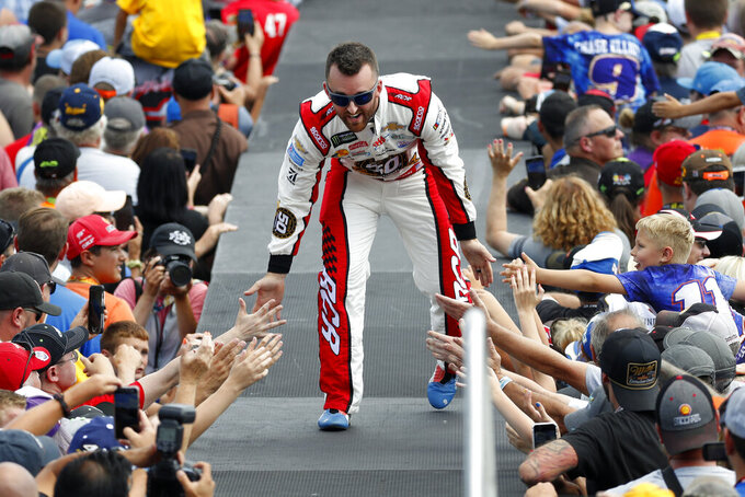 Austin Dillon greets fans before a NASCAR Cup Series auto race at Michigan International Speedway in Brooklyn, Mich., Sunday, Aug. 11, 2019. (AP Photo/Paul Sancya)