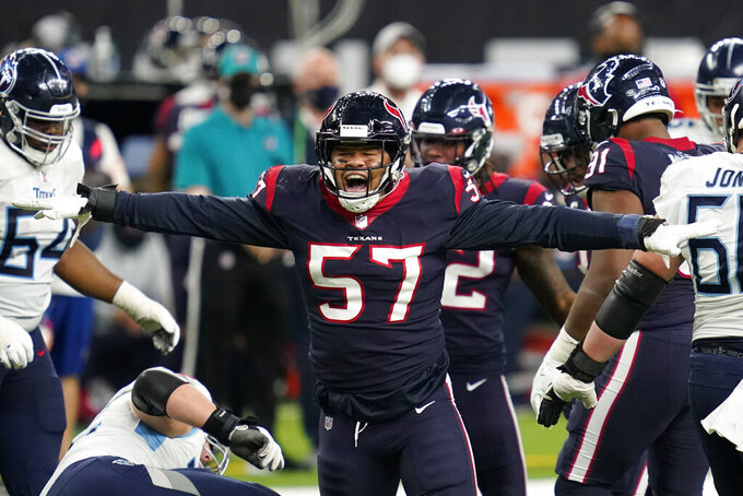 Houston Texans outside linebacker Brennan Scarlett (57) reacts after making a tackle against the Tennessee Titans during the second half of an NFL football game Sunday, Jan. 3, 2021, in Houston. (AP Photo/Sam Craft)