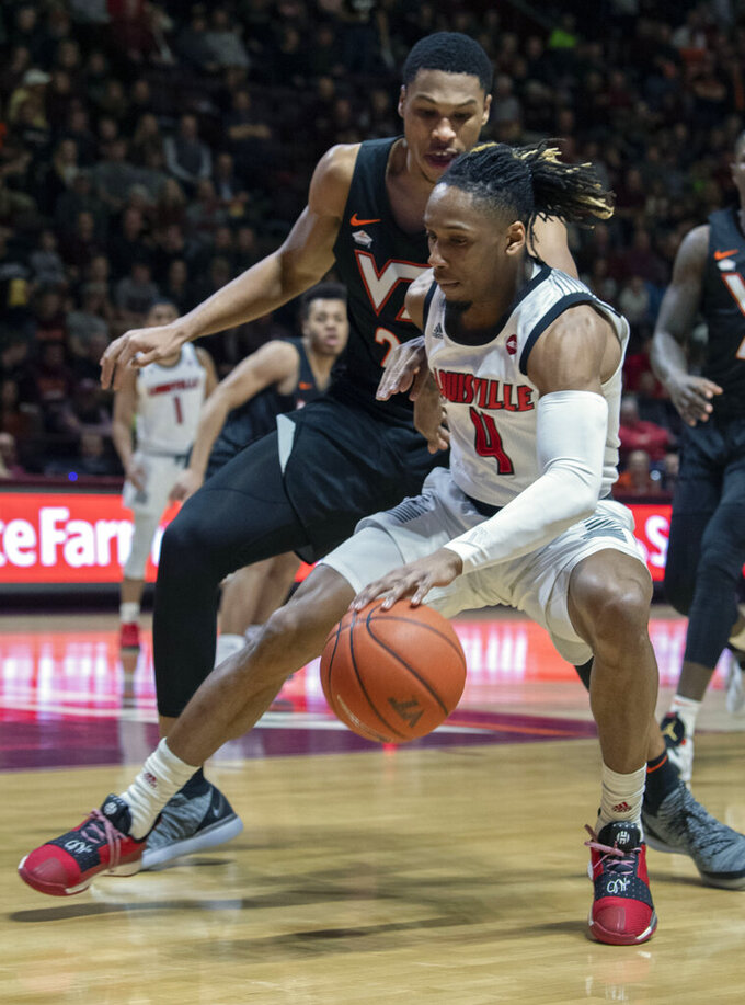 Louisville guard Khwan Fore, right, drives against Virginia Tech Hokies forward Kerry Blackshear Jr., left, during the first half of an NCAA college basketball game Monday, Feb. 4, 2019, in Blacksburg, Va. (AP Photo/Don Petersen)