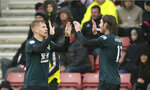 Burnley's Matej Vydra, left, celebrates scoring his side's second goal of the game, during the English Premier League soccer match between Southampton and Burnley at St Mary's Stadium, in Southampton, England, Saturday, Feb. 15, 2020. (Nigel French/PA via AP)