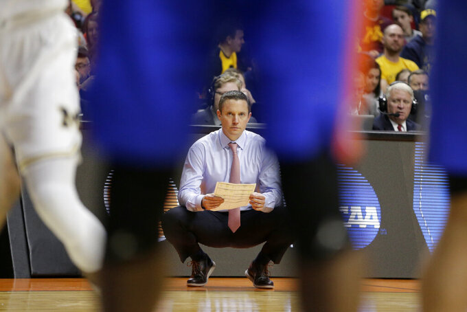 Florida coach Mike White follows the first half of a second round men's college basketball game against Michigan in the NCAA Tournament, in Des Moines, Iowa, Saturday, March 23, 2019. (AP Photo/Nati Harnik)