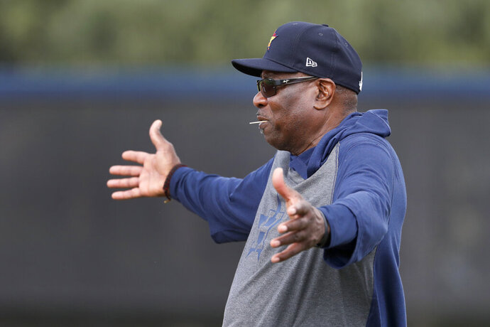 Houston Astros manager Dusty Baker gestures as he watches his team during spring training baseball practice Thursday, Feb. 13, 2020, in West Palm Beach, Fla. (AP Photo/Jeff Roberson)