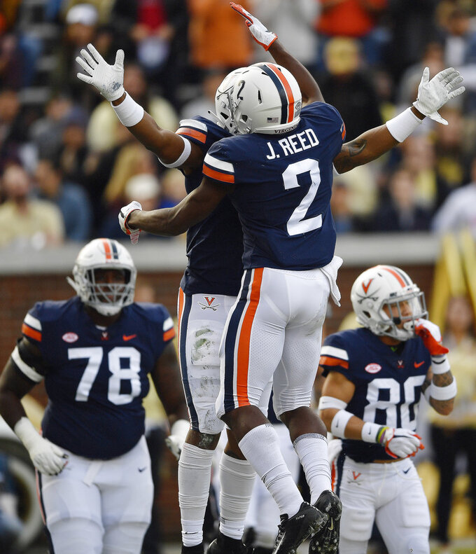 Virginia wide receiver Hasise Dubois (8) celebrates his touchdown catch with Virginia wide receiver Joe Reed (2) against Georgia Tech during the first half of an NCAA football game, Saturday, Nov. 17, 2018, in Atlanta. (AP Photo/Mike Stewart)