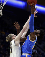 UCLA's Jalen Hill, right, shoots against California's Connor Vanover (23) during the first half of an NCAA college basketball game Wednesday, Feb. 13, 2019, in Berkeley, Calif. (AP Photo/Ben Margot)