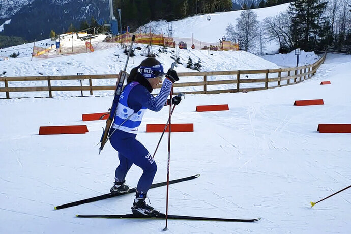 Associated Press reporter Martha Bellisle skis up to the shooting range during the individual Biathalon race during the Winter World Masters Games in Seefeld, Austria on Jan. 14, 2020. (Courtesy of Martha Bellisle via AP)