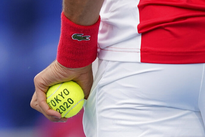 Novak Djokovic, of Serbia, prepares to serve to Jan-Lennard Struff, of Germany, during second round of the tennis competition at the 2020 Summer Olympics, Monday, July 26, 2021, in Tokyo, Japan. (AP Photo/Patrick Semansky)