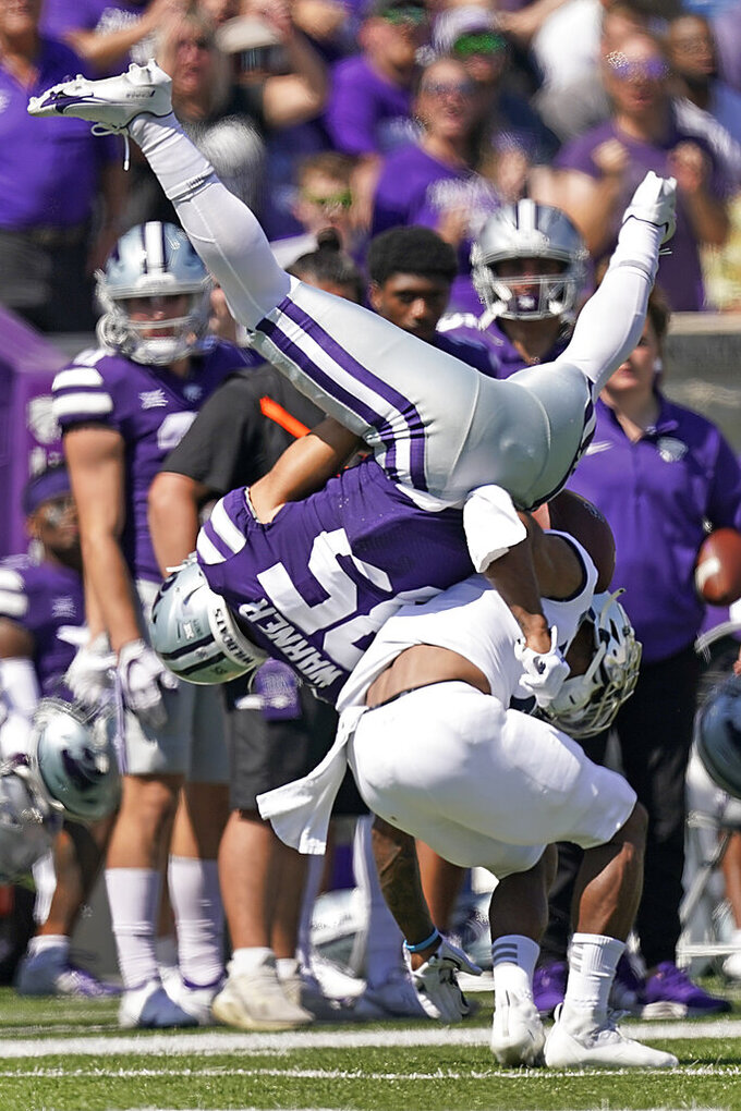 Nevada defensive back Berdale Robbins breaks up a pass intended for Kansas State wide receiver Kade Warner during the first half of an NCAA college football game Saturday, Sept. 18, 2021, in Manhattan, Kan. (AP Photo/Charlie Riedel)