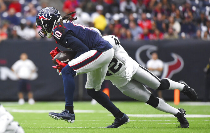 Houston Texans wide receiver DeAndre Hopkins (10) is hit by Oakland Raiders free safety Karl Joseph (42) as he makes a catch during the first half of an NFL football game Sunday, Oct. 27, 2019, in Houston. (AP Photo/Eric Christian Smith)