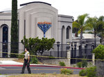 FILE - In this Sunday, April 28, 2019 file photo, a San Diego county sheriff's deputy stands in front of the Poway Chabad Synagogue in Poway, Calif. The gunman who attacked the synagogue last week fired his semi-automatic rifle at Passover worshippers after walking through the front entrance that synagogue leaders identified last year as needing improved security. The synagogue applied for a federal grant to better protect that area. The money, $150,000, was approved in September but only arrived in late March.