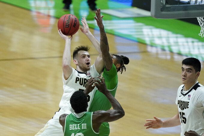 Purdue's Sasha Stefanovic (55) shoots against North Texas's James Reese (0) during the first half of a first-round game in the NCAA men's college basketball tournament at Lucas Oil Stadium, Friday, March 19, 2021, in Indianapolis. (AP Photo/Darron Cummings)