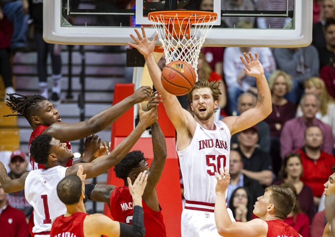 Indiana forward Joey Brunk (50) blocks a shot of Nebraska guard Cam Mack (3) during the second half of an NCAA college basketball game, Friday, Dec. 13, 2019, in Bloomington, Ind. (AP Photo/Doug McSchooler)