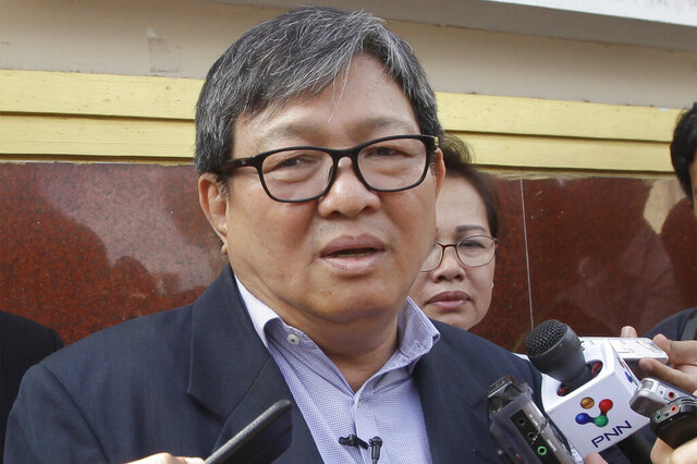 FILE - In this Nov. 7, 2016, file photo, Son Chhay, a lawmaker of the main opposition Cambodia National Rescue Party, speaks to the media in front of Phnom Penh Municipal Court in Phnom Penh, Cambodia, after the court sentenced opposition senator Hong Sok Hour. The prominent former opposition politician in Cambodia had his ban on political activities lifted Thursdayj, Sept. 3, 2020, after the government approved his request for political rehabilitation. The action was made known with publication of a royal decree.(AP Photo/Heng Sinith, File)