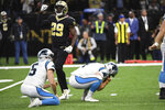 Carolina Panthers kicker Joey Slye (4) reacts after missing a field goal, late in the fourth quarter during an NFL football game against the New Orleans Saints, Sunday, Nov. 24, 2019, in New Orleans. Carolina Panthers punter Michael Palardy (5) holds while New Orleans Saints defensive back Johnson Bademosi (29) reacts. (AP Photo/Bill Feig)
