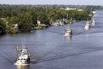 FILE- In this Aug. 27, 2012 file photo, a steady stream of shrimp trawlers make their way up the Intracoastal Waterway near the town of Jean Lafitte, La. Floodwaters carried down from the Midwest are killing oysters and driving crabs, shrimp and finfish out of Louisiana and Mississippi bays and marshes to saltier waters.(Susan Poag/The Times-Picayune via AP, File)