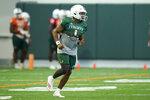 Miami quarterback D'Eriq King runs drills during NCAA college football practice, Tuesday, Aug. 10, 2021, in Coral Gables, Fla. (AP Photo/Lynne Sladky)