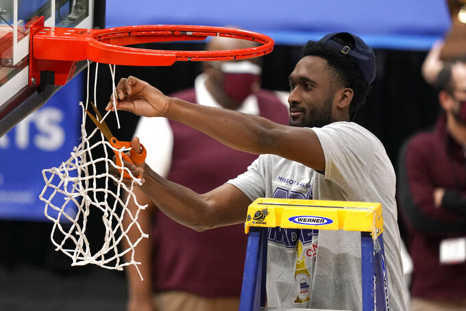 Loyola of Chicago's Keith Clemons cuts down the net in celebration of a 75-65 victory over Drake in the championship game of the NCAA Missouri Valley Conference men's basketball tournament Sunday, March 7, 2021, in St. Louis. (AP Photo/Jeff Roberson)