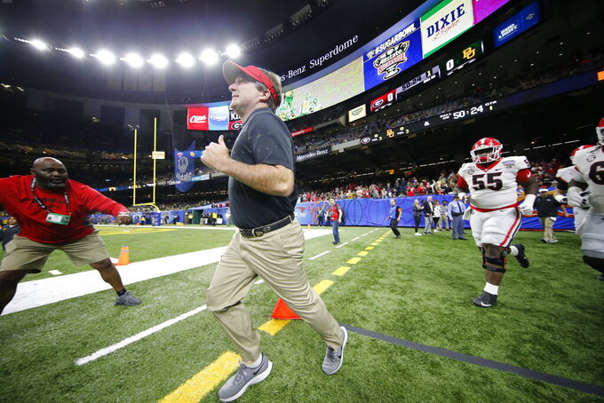 Georgia coach Kirby Smart runs onto the field before the team's Sugar Bowl NCAA college football game against Baylor in New Orleans, Wednesday, Jan. 1, 2020. (AP Photo/Gerald Herbert)