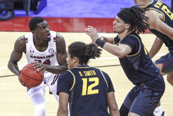 FILE - In this Feb. 20, 2021, file photo, South Carolina forward Keyshawn Bryant (24) is pressured by Missouri guard Dru Smith (12) and forward Kobe Brown (24) during an NCAA college basketball game in Columbia, S.C. Bryant is the top returning scorer for the team at 14.4 points a game last season. (Tracy Glantz/The State via AP, File)