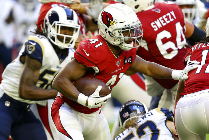 Arizona Cardinals running back Kenyan Drake (41) runs against the Los Angeles Rams during the first half of an NFL football game, Sunday, Dec. 1, 2019, in Glendale, Ariz. (AP Photo/Ross D. Franklin)