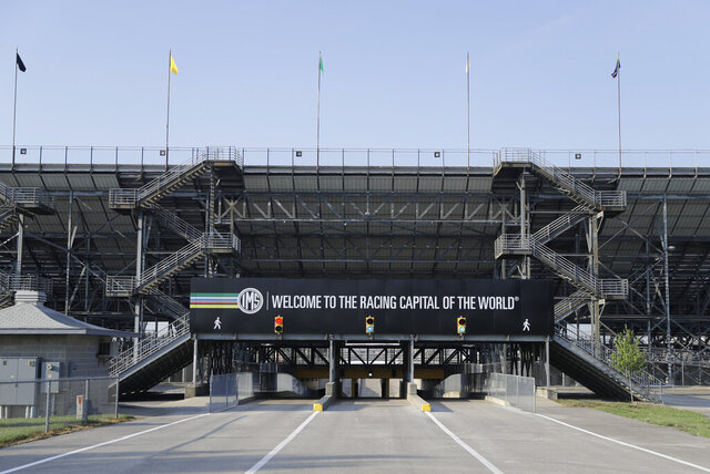 An Indianapolis Motor Speedway signs greets visitors as they enter the north entrance at the Indianapolis Motor Speedway in Indianapolis, Friday, July 3, 2020. Roger Penske has spent the six months since he bought Indianapolis Motor Speedway transforming the facility. He's spent millions on capital improvements to the 111-year-old national landmark and finally gets to showcase some of the upgrades this weekend as NASCAR and IndyCar share the venue in a historic doubleheader. (AP Photo/Darron Cummings)