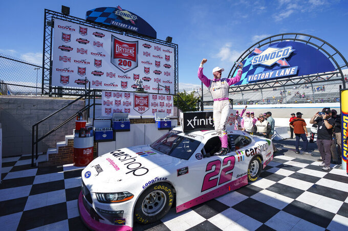 Austin Cindric reacts to his win in Victory Lane following a NASCAR Xfinity Series auto race at Dover International Speedway, Tuesday, June 15, 2021, in Dover, Del. (AP Photo/Chris Szagola)