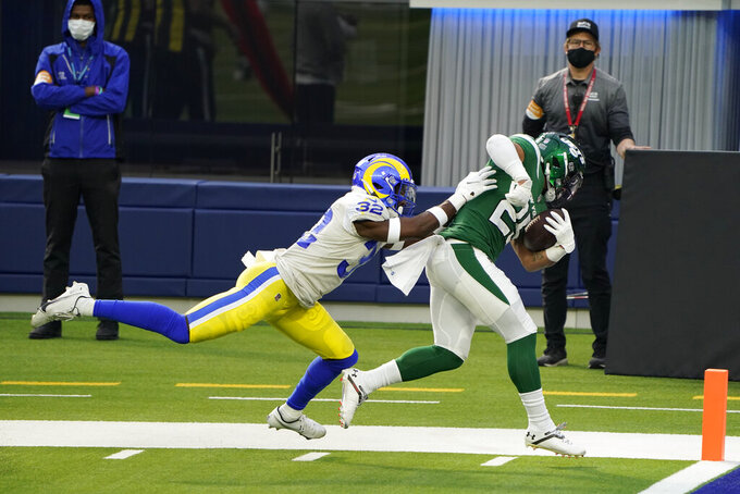 New York Jets running back Ty Johnson, right, scores past Los Angeles Rams strong safety Jordan Fuller (32) during the first half of an NFL football game Sunday, Dec. 20, 2020, in Inglewood, Calif. (AP Photo/Jae C. Hong)