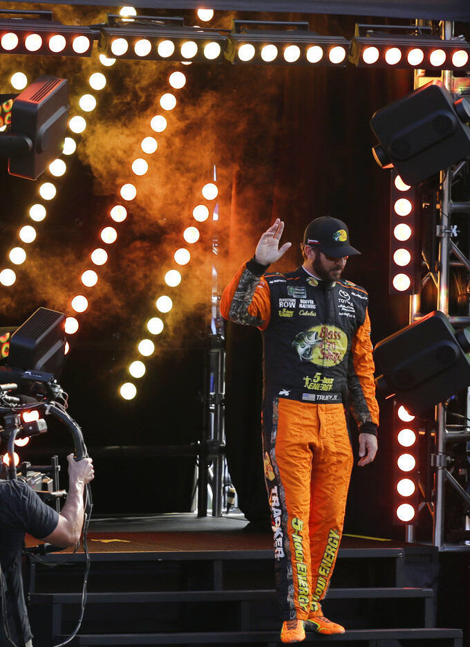 Martin Truex Jr. is introduced before a NASCAR Cup Series Championship auto race at the Homestead-Miami Speedway, Sunday, Nov. 18, 2018, in Homestead, Fla. (AP Photo/Terry Renna)