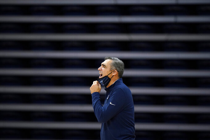 Villanova head coach Jay Wright yells to his team during the second half of an NCAA college basketball game against Butler, Wednesday, Dec. 16, 2020, in Villanova, Pa. (AP Photo/Matt Slocum)