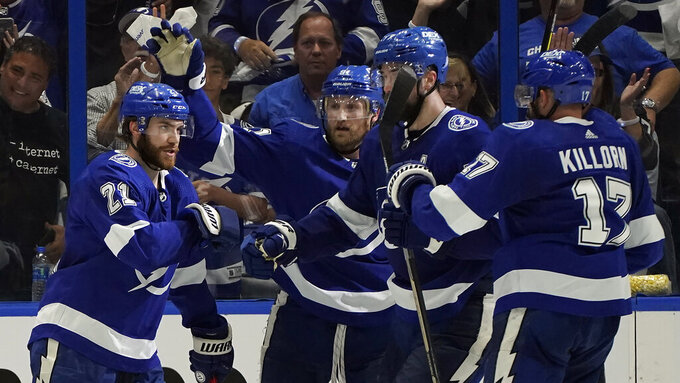 Tampa Bay Lightning center Brayden Point (21) celebrates with teammates after scoring against the New York Islanders during the third period in Game 1 of an NHL hockey Stanley Cup semifinal playoff series Sunday, June 13, 2021, in Tampa, Fla. (AP Photo/Chris O'Meara)