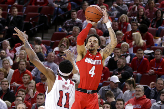 FILE - In this Feb. 27, 2020, file photo, Ohio State's Duane Washington Jr. (4) shoots over Nebraska's Dachon Burke Jr. (11) during the first half of an NCAA college basketball game in Lincoln, Neb. (AP Photo/Nati Harnik, File)