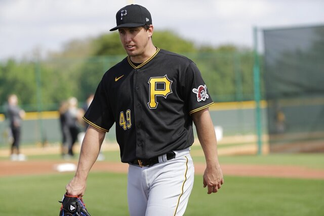 FILE - In this Feb. 17, 2020, file photo, Pittsburgh Pirates' Derek Holland is shown during a spring training baseball workout in Bradenton, Fla. Holland is one of several older players trying to hang on with teams that don't figure to be contenders in 2020. (AP Photo/Frank Franklin II, File)