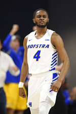 Hofstra guard Desure Buie reacts after he made a basket during the first half of the team's NCAA college basketball game against Northeastern for the championship of the Colonial Athletic Association men's tournament Tuesday, March 10, 2020, in Washington. (AP Photo/Nick Wass)