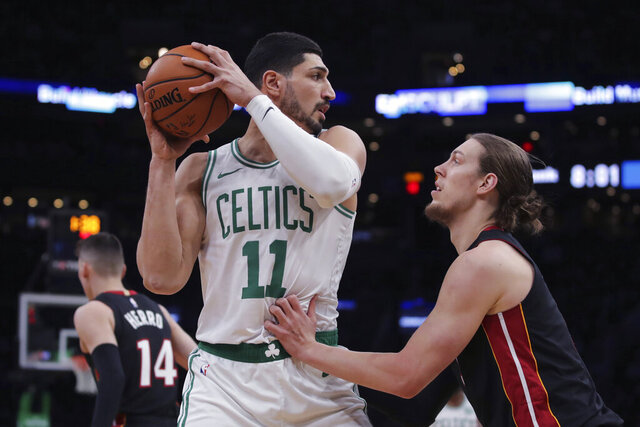 Boston Celtics center Enes Kanter (11) looks to pass as he is covered by Miami Heat forward Kelly Olynyk, right, during the first half of an NBA basketball game in Boston, Wednesday, Dec. 4, 2019. (AP Photo/Charles Krupa)