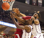 Texas A&M's Emanuel Miller (5) and Josh Nebo (32) vie for a rebound against Arkansas' Adrio Bailey (2) during an NCAA college basketball game game at Reed Arena in College Station, Texas, Saturday, March 7, 2020. (Michael Miller/College Station Eagle via AP)