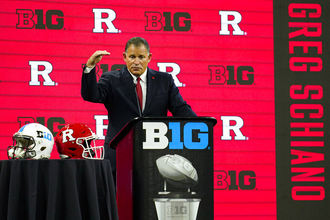 FILE - Rutgers head coach Greg Schiano gestures while talking to reporters during an NCAA college football news conference at the Big Ten Conference media days at Lucas Oil Stadium in Indianapolis, in this Friday, July 23, 2021, file photo. Expectations are higher this season with Schiano returning all 11 starters on offense, nine on defense, plus the punter, placekicker and long snapper. (AP Photo/Michael Conroy, File)