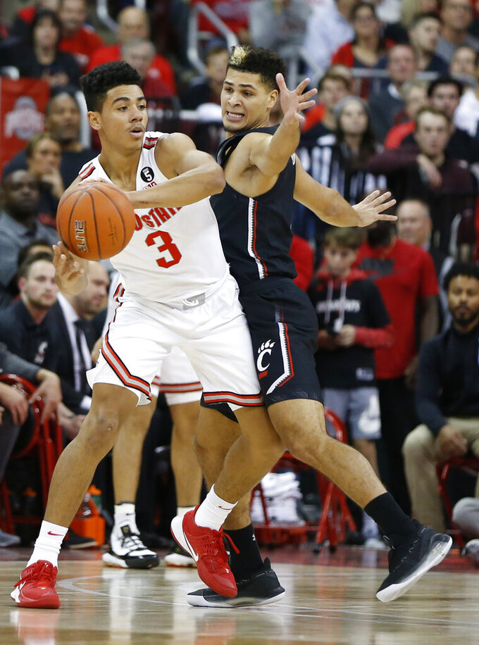Ohio State's D.J. Carton, left, keeps the ball away from Cincinnati's Jaevin Cumberland during the first half of an NCAA college basketball game Wednesday, Nov. 6, 2019, in Columbus, Ohio. (AP Photo/Jay LaPrete)