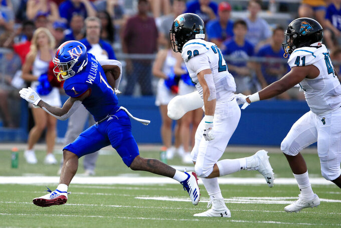Kansas running back Pooka Williams Jr. (1) runs away from Coastal Carolina linebackers Silas Kelly (29) and Myles Olufemi (41) during the first half of an NCAA college football game in Lawrence, Kan., Saturday, Sept. 7, 2019. (AP Photo/Orlin Wagner)