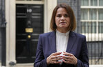 Belarus opposition leader Sviatlana Tsikhanouskaya speaks to the media outside 10 Downing Street after a meeting with the British Prime Minister Boris Johnson in London, Tuesday, Aug. 3, 2021. (AP Photo/Alastair Grant)