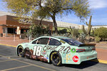 NASCAR driver Kyle Busch's car is parked outside Ethel M Chocolates in Henderson, Nev. Busch first went to the Ethel M candy factory with his grandmother. It wasn't a tourist stop to the young Busch, it was a candy store and his grandmother let him roam the cactus garden and rewarded him with the craft chocolates. Ethel M is part of the Mars Corp., the longtime sponsor of Busch's team. Busch will feature the brand on his car in Sunday's race.  (AP Photo/Jenna Fryer)