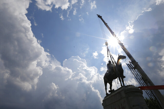 Work crews work to remove the statue of confederate general Stonewall Jackson, Wednesday, July 1, 2020, in Richmond, Va. Richmond Mayor Levar Stoney has ordered the immediate removal of all Confederate statues in the city, saying he was using his emergency powers to speed up the healing process for the former capital of the Confederacy amid weeks of protests over police brutality and racial injustice. (AP Photo/Steve Helber)