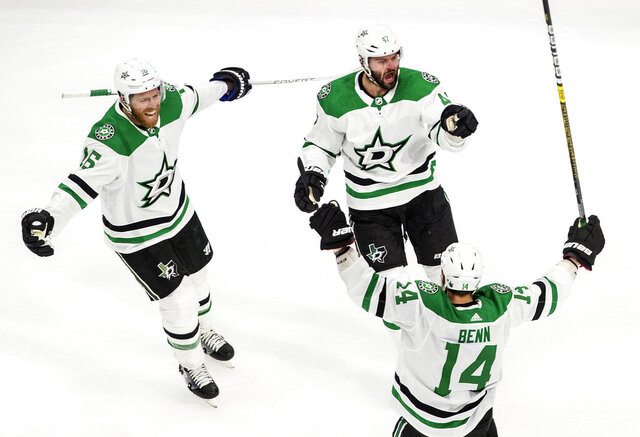 Dallas Stars' Joe Pavelski (16), Alexander Radulov (47) and Jamie Benn (14) celebrate a goal against the Colorado Avalanche during third-period NHL Western Conference Stanley Cup playoff game action in Edmonton, Alberta, Friday, Sept. 4, 2020. (Jason Franson/The Canadian Press via AP)